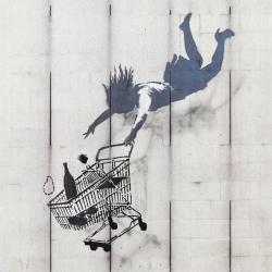 Woman falling with shopping cart
