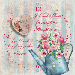 Watering can with flowers and heart
